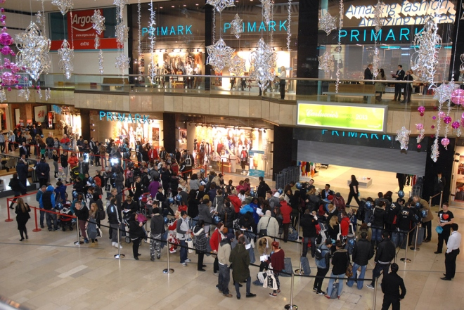 People queuing outside Primark in a shopping mall